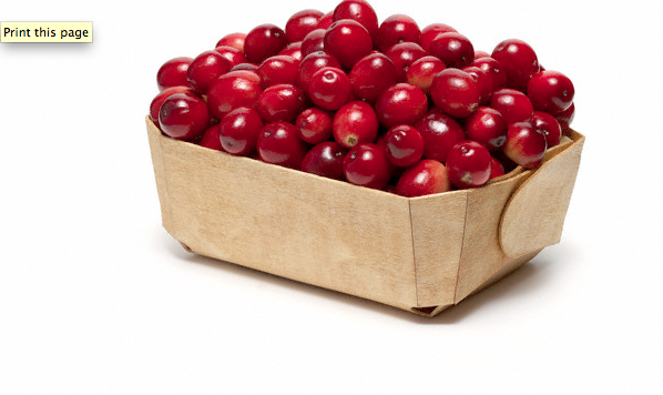 A wooden basket of cranberries
