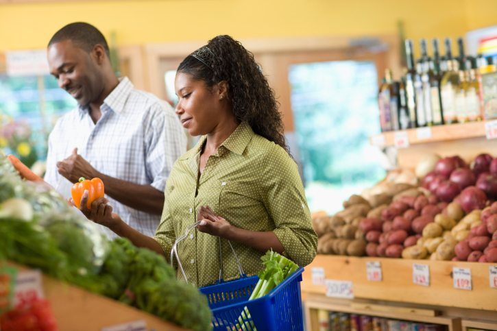 African American couple grocery shopping