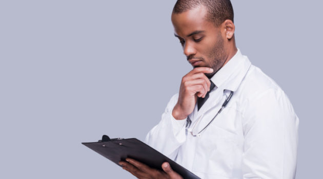doctor looking at chart