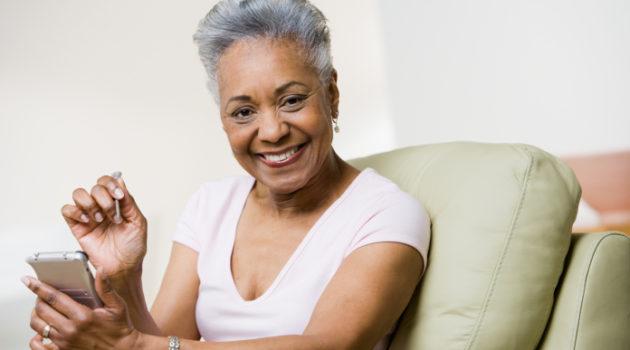 senior african american woman holding organizer
