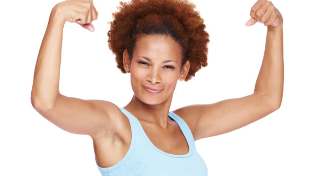 african american woman flexing her arm muscles
