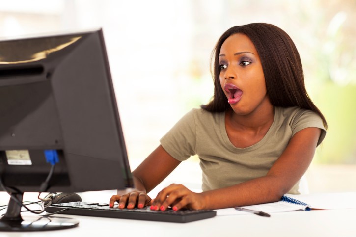 cute african young woman using instant message