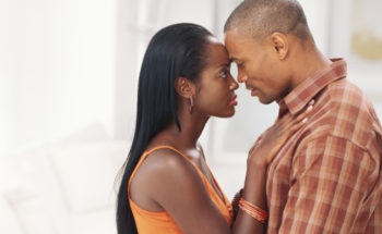 young african american couple standing face to face