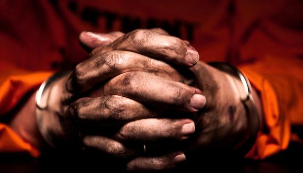 African American Black man hands in prison
