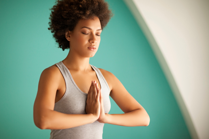 African American Black woman yoga meditation prayer position