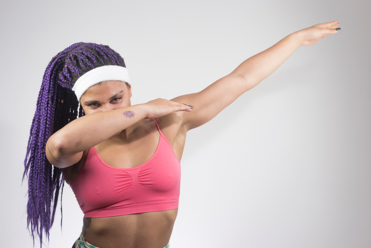 African American woman with braids dab dance