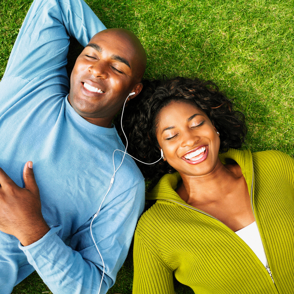 African American couple listening to music outside