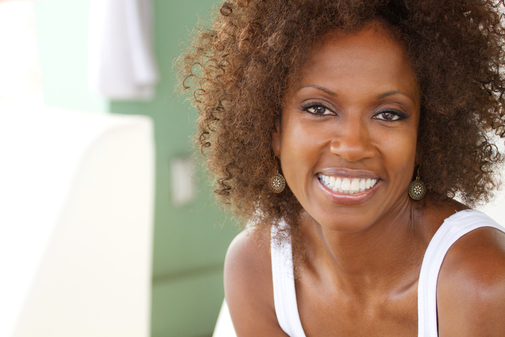 woman smiling natural hair