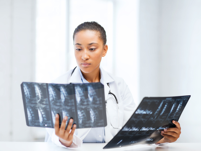 African American woman doctor looking at x-ray