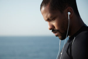 African American man stressed listening to music