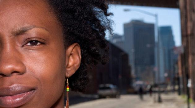 African American woman on city sidewalk