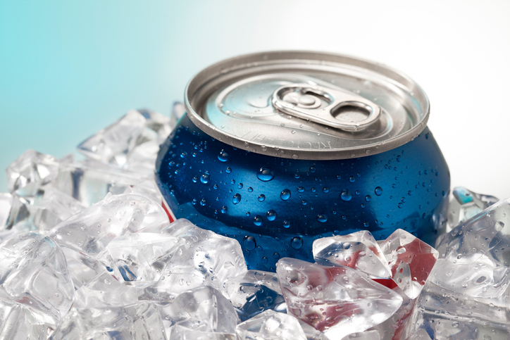 can of soda on ice