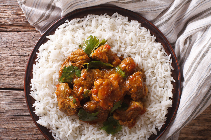 Indian food: Madras beef with basmati rice on the table close-up. horizontal view from above